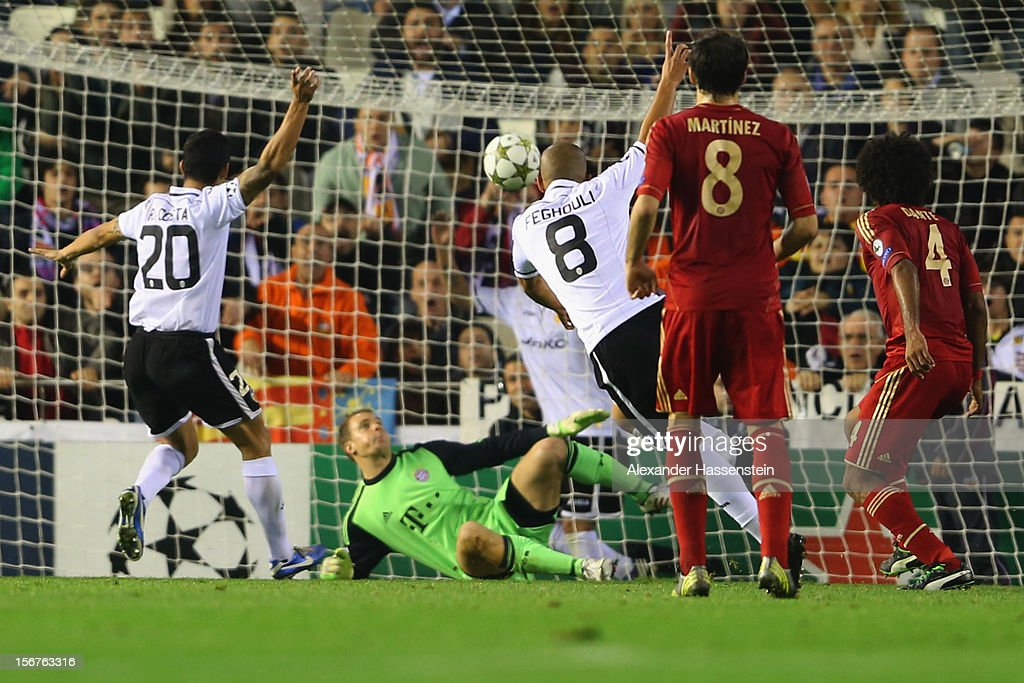 Sofiane Feghouli (#8) of Valencia scores the opening goal against Manuel Neuer, keeper of Muenchen during the UEFA Champions League group F match between Valencia FC and FC Bayern Muenchen at Estadio Mestalla on November 20, 2012 in Valencia, Spain.