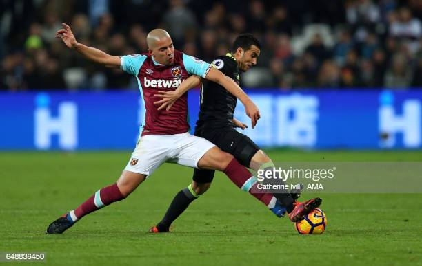 Sofiane Feghouli of West Ham and Pedro of Chelsea during the Premier League match between West Ham United and Chelsea at London Stadium on March 6...