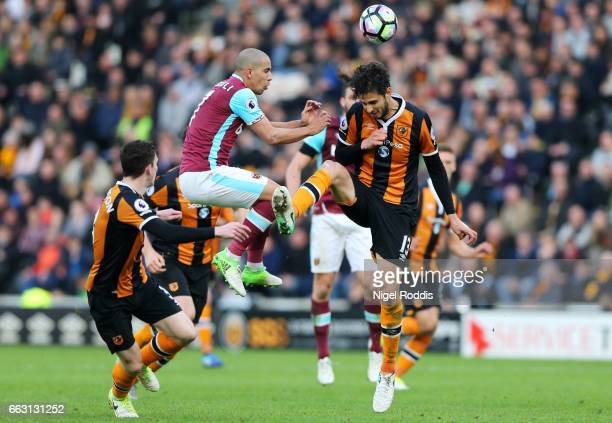 Sofiane Feghouli of West Ham United and Andrea Ranocchia of Hull City battle to win a header during the Premier League match between Hull City and...