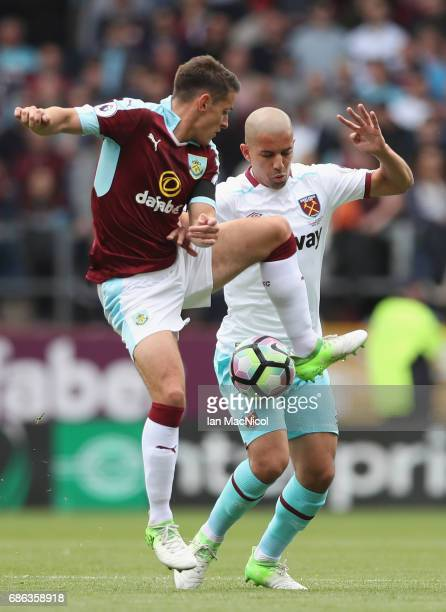 Sofiane Feghouli of West Ham United and Ashley Westwood of Burnley battle for possession during the Premier League match between Burnley and West Ham...