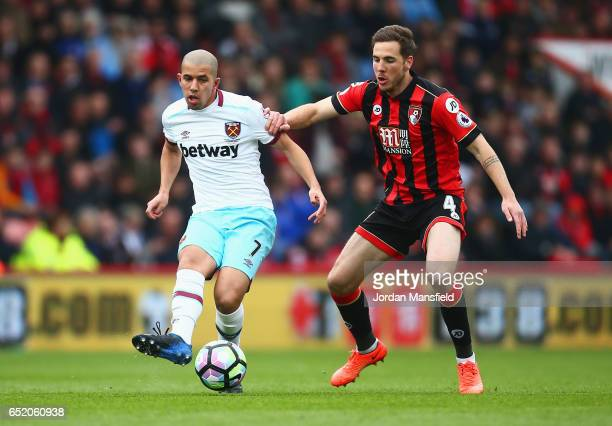 Sofiane Feghouli of West Ham United and Dan Gosling of AFC Bournemouth battle for possession during the Premier League match between AFC Bournemouth...