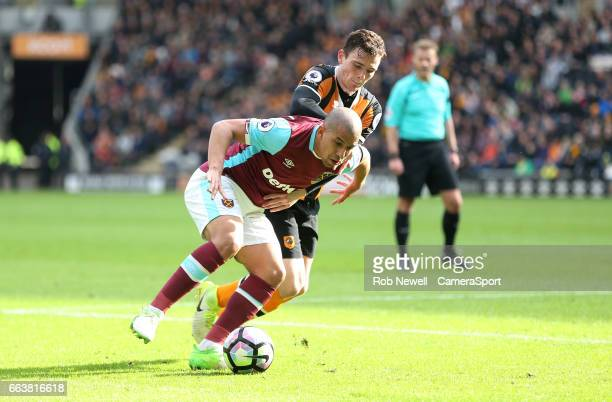 Sofiane Feghouli of West Ham United and Hull City's Andrew Robertson during the Premier League match between Hull City and West Ham United at KCOM...