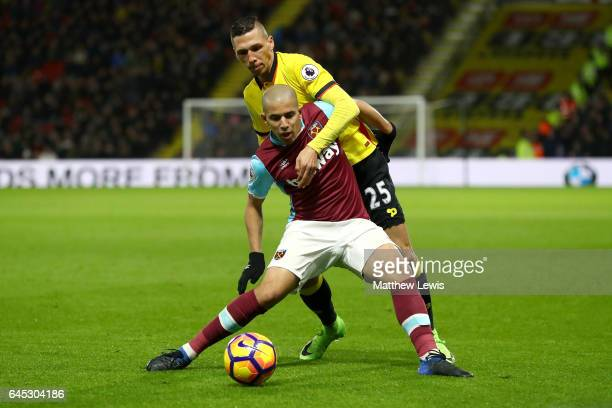 Sofiane Feghouli of West Ham United and Jose Holebas of Watford battle for possession during the Premier League match between Watford and West Ham...