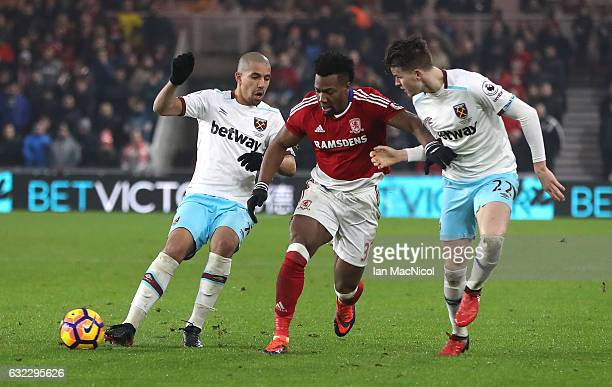 Sofiane Feghouli of West Ham United and Sam Byram of West Ham United attempt to tackle Adama Traore of Middlesbrough during the Premier League match...