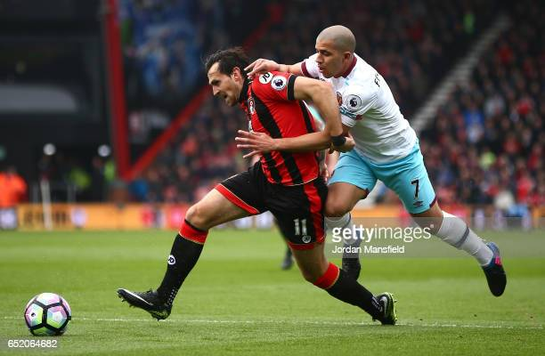 Sofiane Feghouli of West Ham United fouls Charlie Daniels of AFC Bournemouth and a penalty is awarded to AFC Bournemouth during the Premier League...