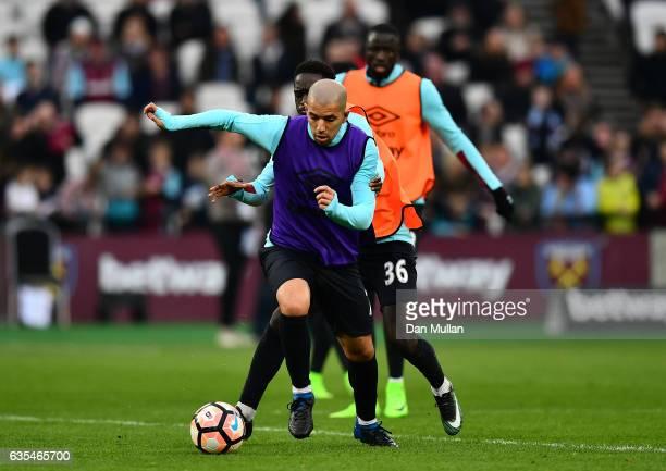 Sofiane Feghouli of West Ham United holds off Domingos Quina of West Ham United during a West Ham United family fun day at London Stadium on February...