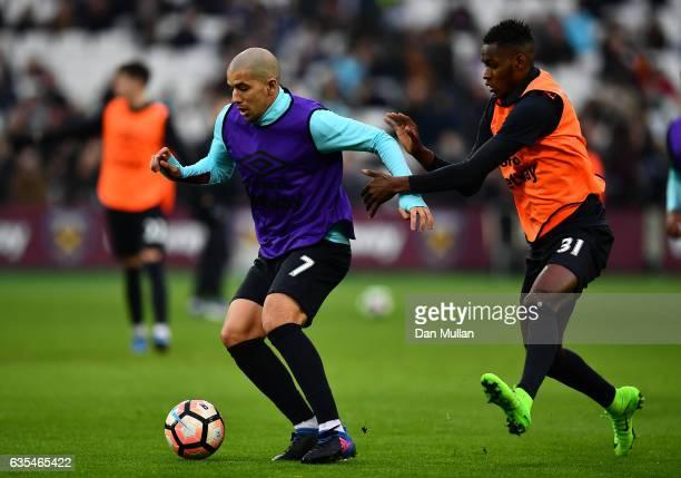 Sofiane Feghouli of West Ham United holds off Edimilson Fernandes of West Ham United during a West Ham United family fun day at London Stadium on...