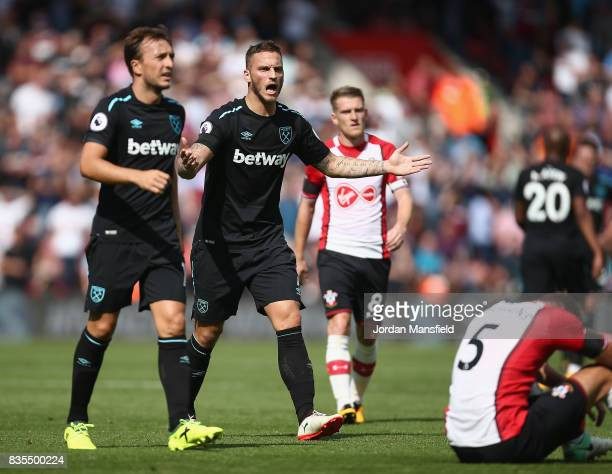 Sofiane Feghouli of West Ham United is shown a red card during the Premier League match between Southampton and West Ham United at St Mary's Stadium...