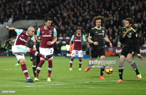 Sofiane Feghouli of West Ham United shoots on goal during the Premier League match between West Ham United and Chelsea at London Stadium on March 6...
