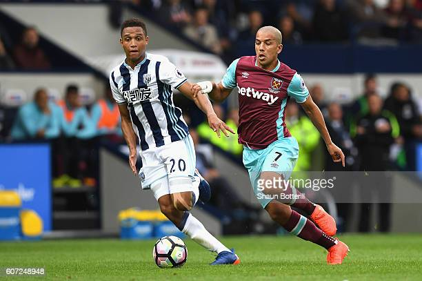 Sofiane Feghouli of West Ham United takes the ball past Brendan Galloway of West Bromwich Albion during the Premier League match between West...