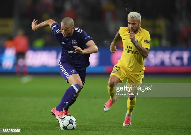 Sofiane Hanni of RSC Anderlecht breaks away from Dani Alves of Paris SaintGermain during the UEFA Champions League group B match between RSC...