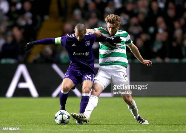 Sofiane Hanni of RSC Anderlecht is challenged by Stuart Armstrong of Celtic during the UEFA Champions League group B match between Celtic FC and RSC...
