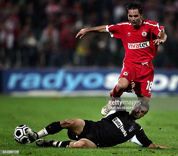Sofia's Florentin Petre jumps over Besiktas's defender Ali Tandogan during their UEFA Cup football match in Sofia 28 September 2006 AFP PHOTO /...