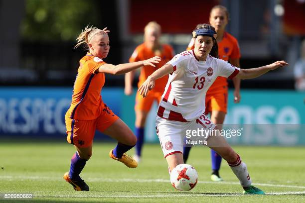 Sofie Junge Pedersen of Denmark holds off pressure from Jackie Groenen of the Netherlands during the Final of the UEFA Women's Euro 2017 between...