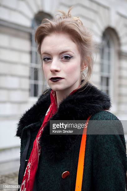 Sofie king wearing Alexander Mcqueen scarf Topshop coat and skirt Bag Cambridge satchel company street style at London fashion week autumn/winter...