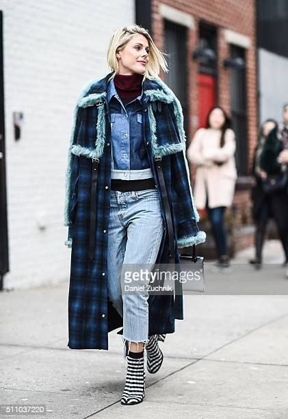 Sofie Valkiers is seen outside the DKNY show wearing a blue and black plaid coat blue shirt blue jeans and black and white striped shoes during New...
