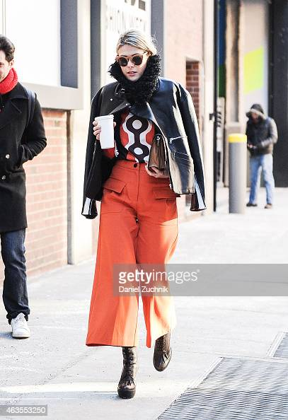 Sofie Valkiers is seen outside the Tim Coppens show wearing Giulietta NY trousers Jamie Wei Huang coat Animale Brasil bag and Ralph Lauren boots on...