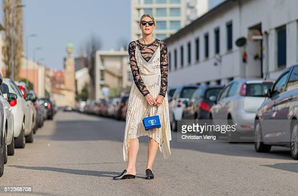 Sofie Valkiers is wearing a creme dress a black sheer top black slippers and a blue bag from Emilio Pucci seen outside Emilio Pucci during Milan...