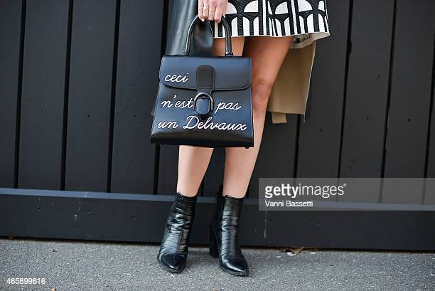 Sofie Valkiers poses wearing a Gerard Darel coat Silvian Heach dress and Delvaux bag on Day 9 of Paris Fashion Week Womenswear FW15 on March 11 2015...