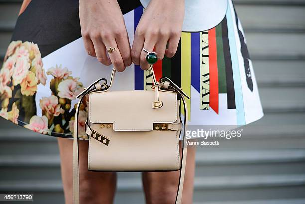 Sofie Valkiers poses wearing a Ground Zero dress Delvaux bag Louis Vuitton bracelet and Dior shoes on September 27 2014 in Paris France