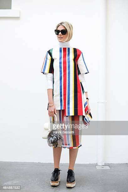 Sofie Valkiers poses wearing a Marni dress Tod's bag and Stella McCartney shoes on March 1 2015 in Milan Italy