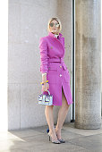 Sofie Valkiers poses wearing Emilio Pucci coat Paula Cademartori bag and Aperlai shoes on February 26 2015 in Milan Italy