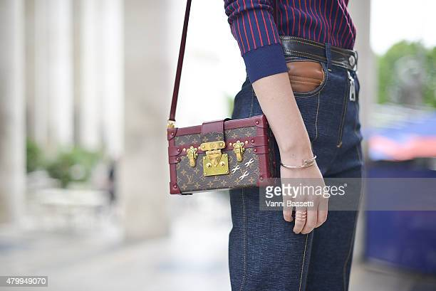 Sofie Valkiers poses wearing Louis Vuitton before the Viktor and Rolf show at the Palais de Tokyo on July 8 2015 in Paris France