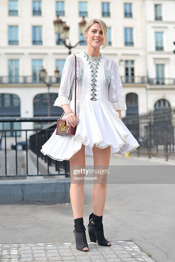 Sofie Valkiers poses wearing Louis Vuitton dress and bag before the Atelier Versace show at the Palais Brogniart on July 5 2015 in Paris France