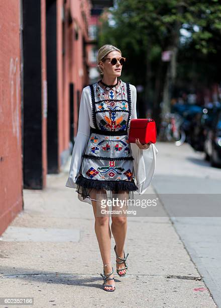 Sofie Valkiers wearing a white dress with long sleeves Louis Vuitton bag and heels outside Tibi on September 10 2016 in New York City