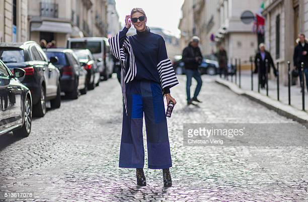 Sofie Valkiers wearing Dior sunglasses Wim Bruynooghe navy sweater Louis Vuitton bag and Rodebjer pants outside Balmain during the Paris Fashion Week...