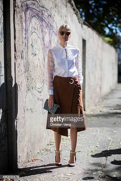 Sofie Valkiers wears Cote shirt Patrizia Pepe bag Tibi skirt Louis Vuitton shoes during Milan Fashion Week Spring/Summer 16 on September 24 2015 in...