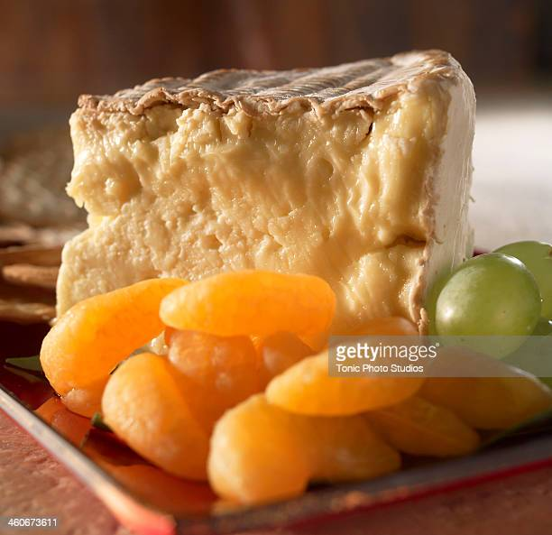 Soft cheese on tray with fruits