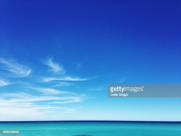 Soft clouds over calm turquoise colored ocean