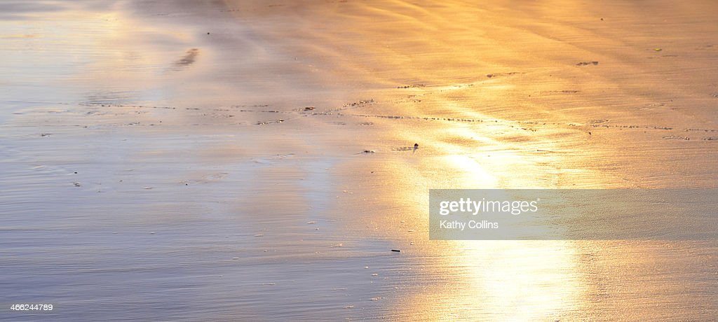 Soft glowing evening sunlight on water