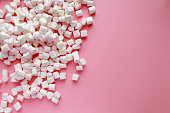 Soft pink and white marshmallows on bright pink background. Flat lay, top view. gentle background  with candies with copy space.