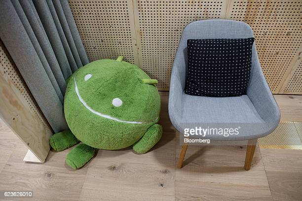 A soft toy depicting the Android logo sits in a workspace at Google Inc's Kings Cross office in London UK on Tuesday Nov 15 2016 After being...