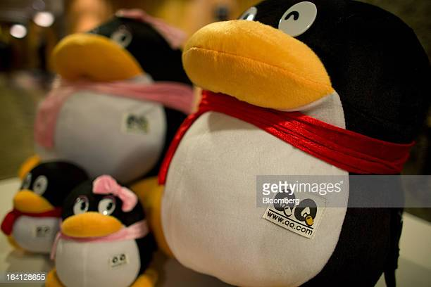 Soft toys promoting QQcom operated by Tencent Holdings Ltd are seen displayed at a news conference in Hong Kong China on Wednesday March 20 2013...