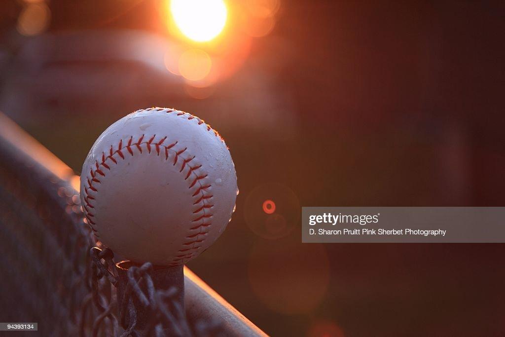 Softball and Pixie Bubbles at Sundown : Stock Photo