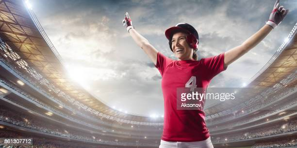 Softball female player happy after the victory on a professional arena