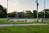 a softball field at dawn waiting the days games