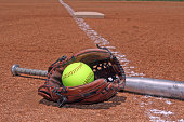 yellow ball bat and glove on the softball baseball field