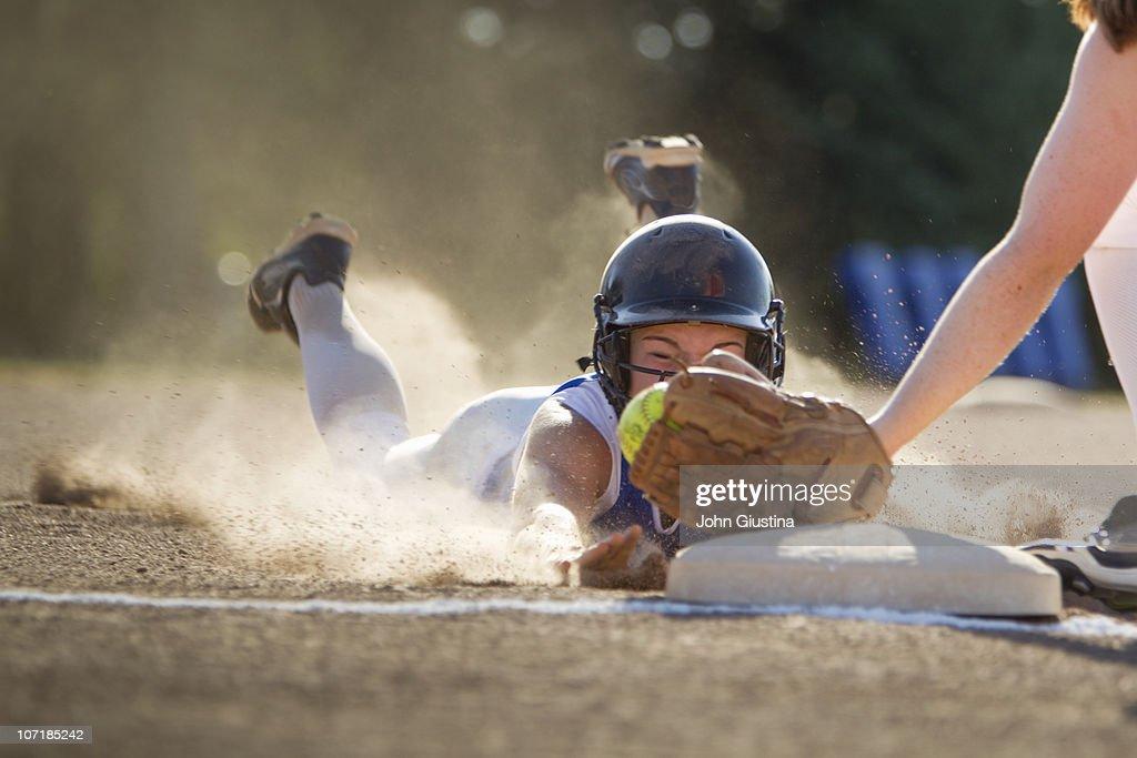 Softball player slides head first. : Stock Photo