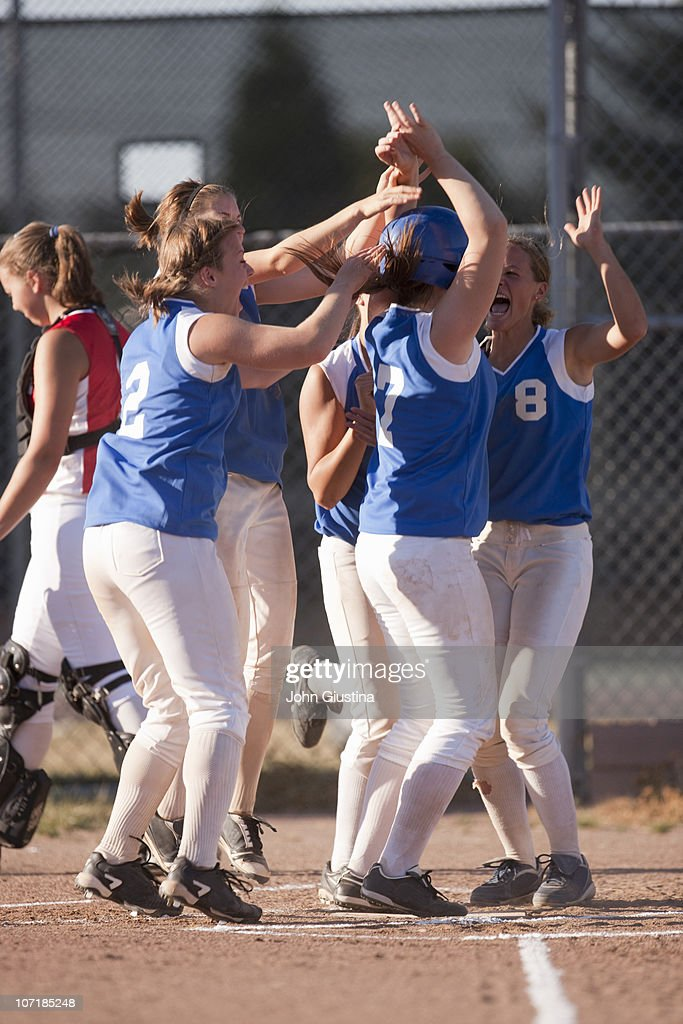 Softball players celebrate. : Stock Photo