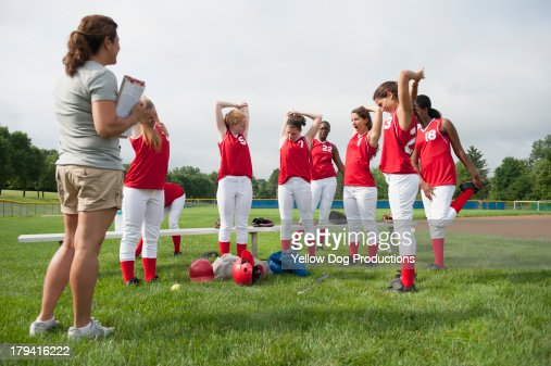 Softball Players Stretching with their coach : Stock Photo