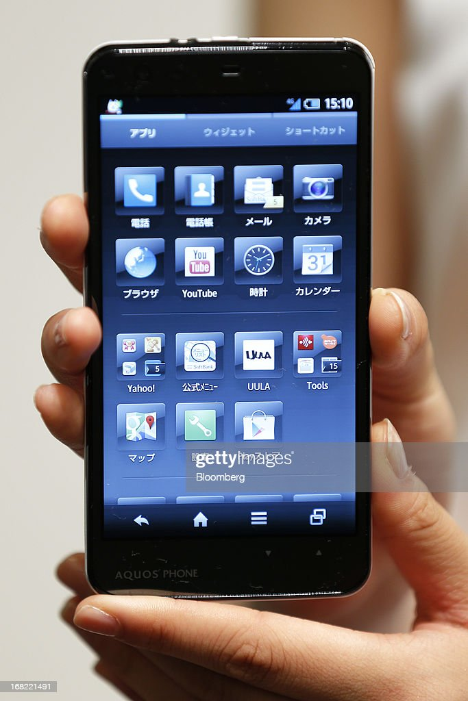 A SoftBank Corp. Aquos Phone Xx 206SH smartphone, manufactured by Sharp Corp., is displayed for a photograph during a product launch in Tokyo, Japan, on Tuesday, May 7, 2013. SoftBank President Masayoshi Son will visit the U.S. to meet with Sprint Nextel Corp. institutional investors to discuss the company's proposed takeover, SoftBank spokesman Mitsuhiro Kurano said today. Photographer: Kiyoshi Ota/Bloomberg via Getty Images