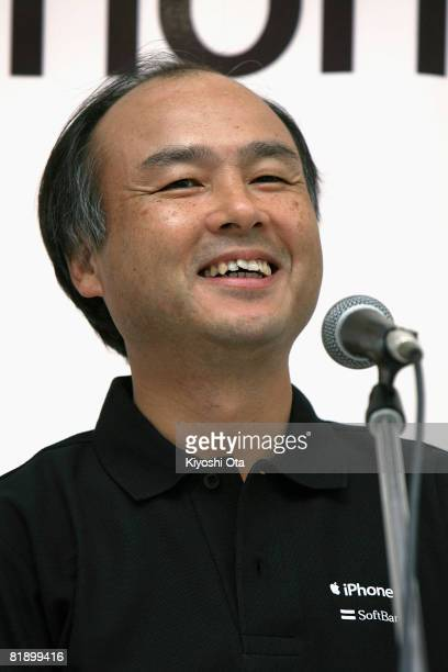 SoftBank Corp President and CEO Masayoshi Son speaks during a countdown ceremony for the newly released Apple iPhone on the first day of its Japanese...