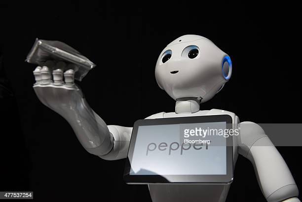 SoftBank Corp's Pepper humanoid robot stands during a news conference in Urayasu Chiba Prefecture Japan on Thursday June 18 2015 SoftBank will start...