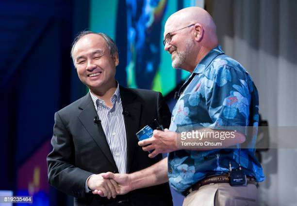 SoftBank Group Corp Chief Executive Officer Masayoshi Son left shakes hands with Boston Dynamics Inc Founder and Chief Executive Officer Marc Raibert...