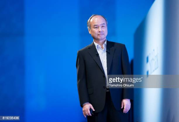 SoftBank Group Corp Chief Executive Officer Masayoshi Son looks on as he delivers a keynote speech during the SoftBank World 2017 conference on July...