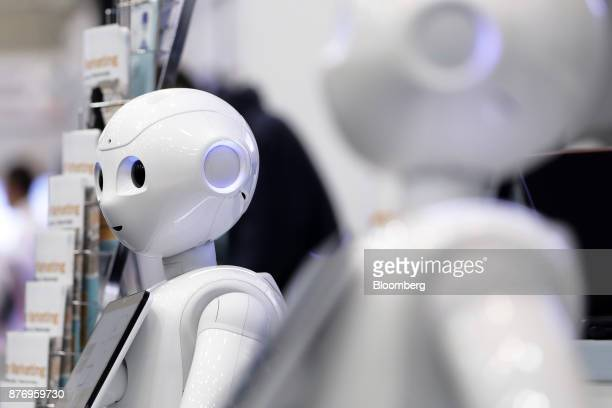 A SoftBank Group Corp Pepper humanoid robot stands at the SoftBank Robot World 2017 in Tokyo Japan on Tuesday Nov 21 2017 SoftBank Chief Executive...